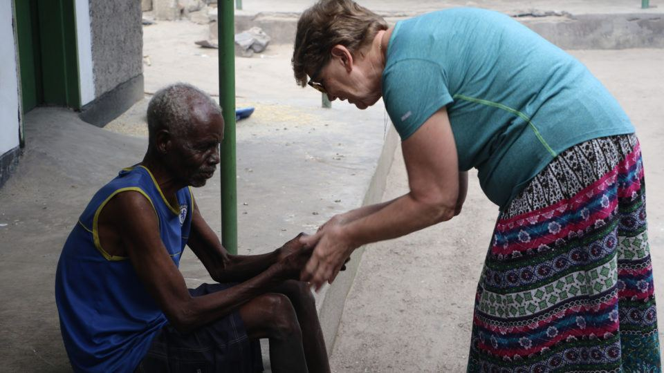 Beverly Farinelli in Mwandi with blind man, Robert.