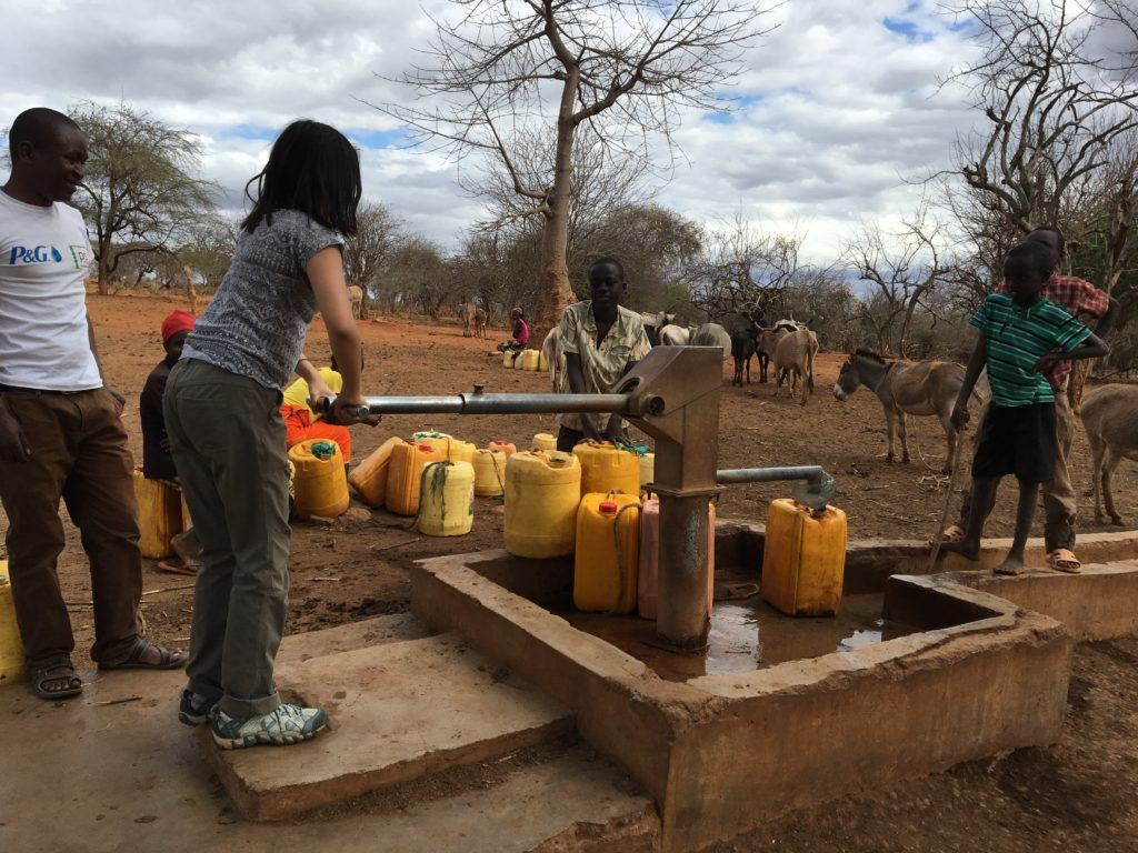 cathryn pumping water from a well in Mutmo