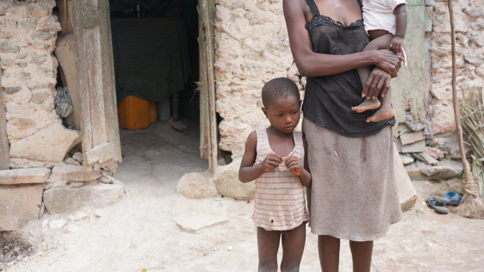 Young Dieukine with his mother at their home in Haiti.