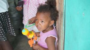 Francesca at her home in Haiti with her older sister, Laurie.