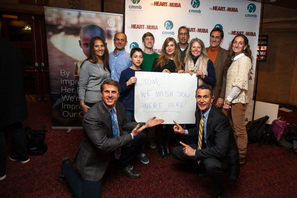 Ken Carlson (bottom left) with many members of Tom Catena's family, and CMMB President and CEO, Bruce Wilkinson (bottom right) at the premiere of The Heart of Nuba in NYC.