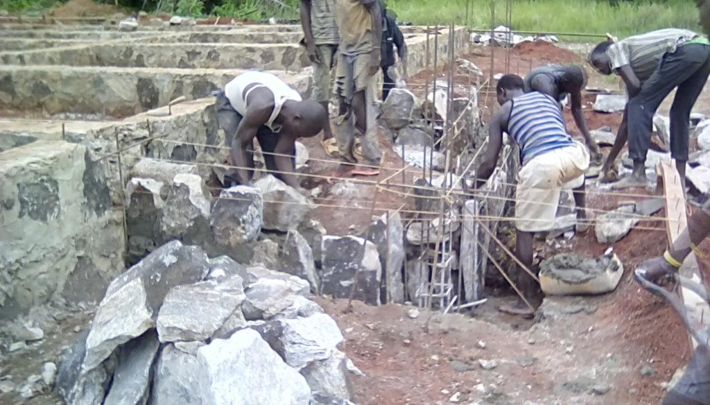 Masons lay the Veranda Foundation at Theatre