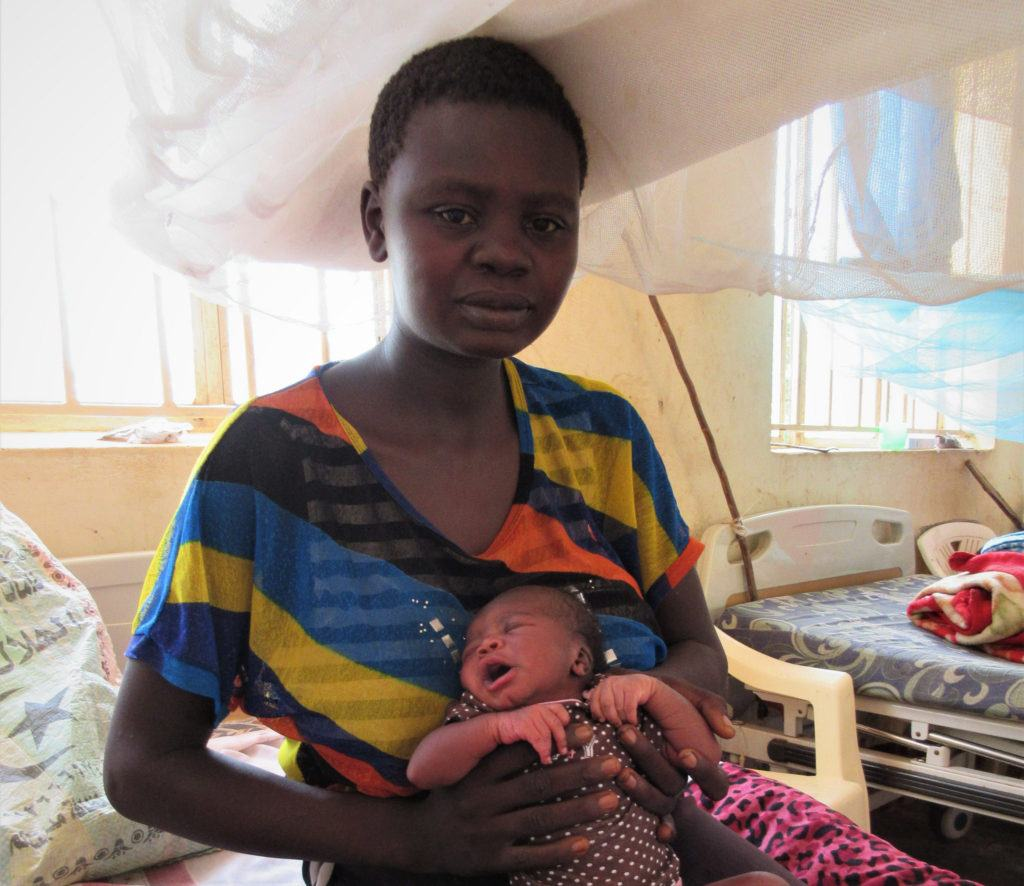 Newborn Sarah with her mother, Nevar, the day after the birth.