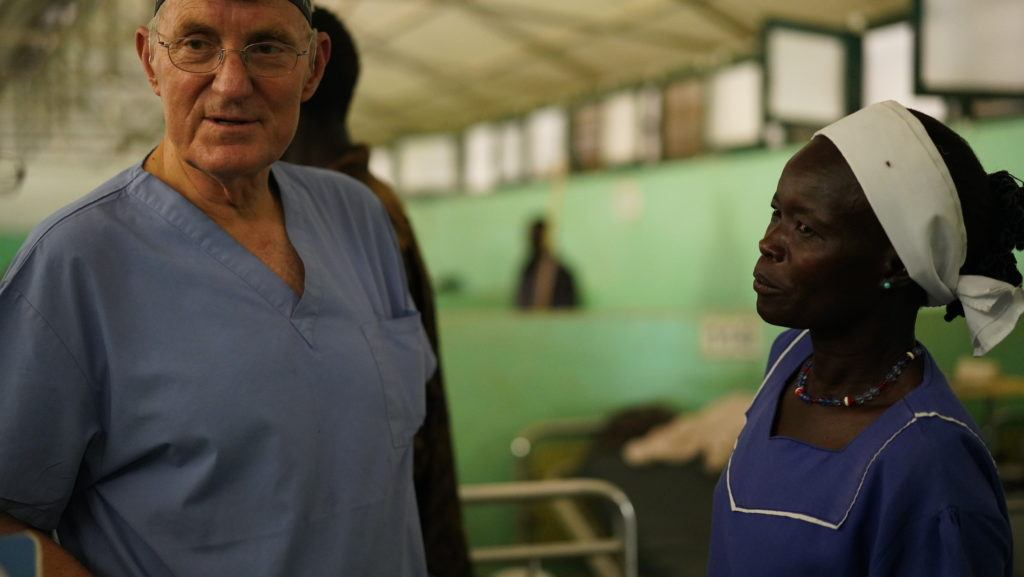 Dr. Jim Peck with one of the nurses at the Nuba Hospital