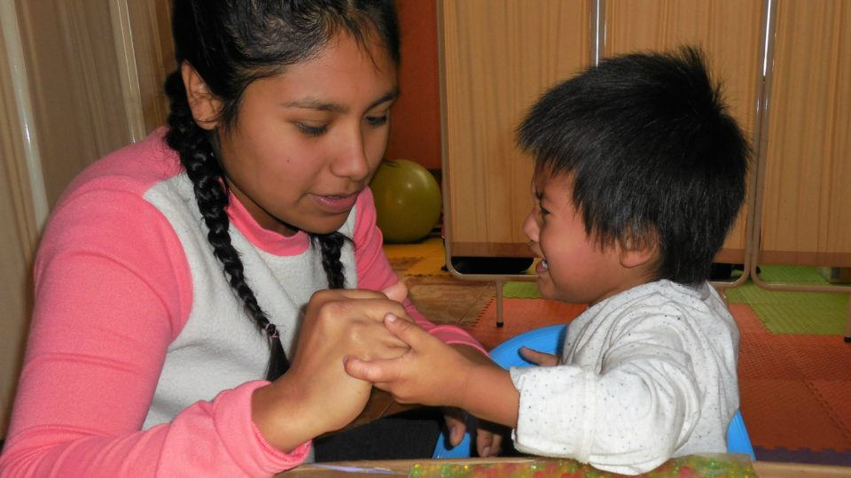 Jordan in a therapy session - CMMB Peru Angel