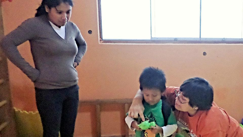 Jordan, participating in a therapy session with his mom - CMMB Peru Angel