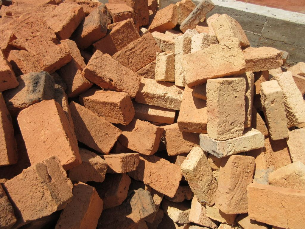 Picture of the various kinds of bricks received for building project at St. Theresa Hospital in Nzara, South Sudan.