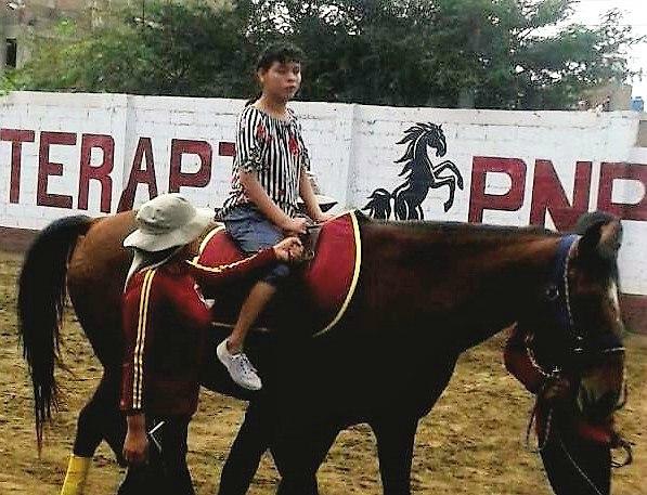 Laura riding a horse - CMM