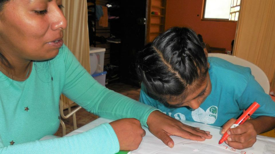 Leslie completing a therapy activity - CMMB Peru Angel