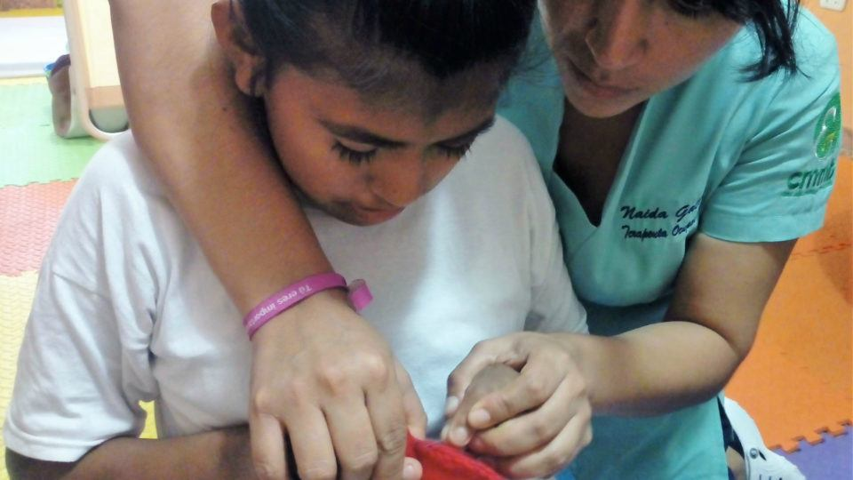 Leslie works hard in therapy - CMMB Peru Angel