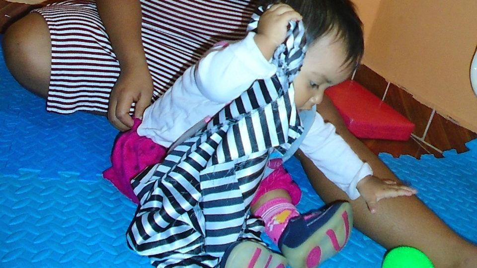 María during one of her therapy sessions - CMMB Peru Angel