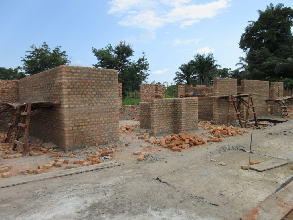 Progress on the operating theatre at S. Theresa as of July 15. Brick walling of the partitions is coming up.