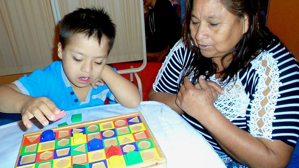Rodrigo completing a puzzle - CMMB Peru Angel