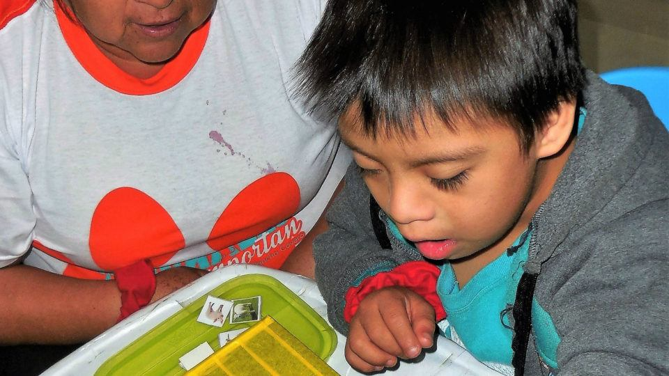 Rodrigo participating in a therapy activity - CMMB Peru Angel
