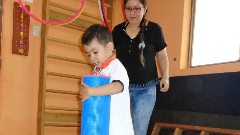 Thiago works hard during every therapy session - CMMB Peru Angel