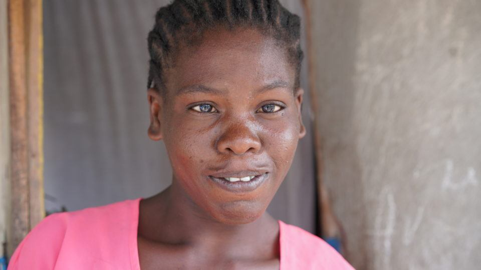 Etiene's mom, Louina. She has an eye condition that she has not been able to get fixed.
