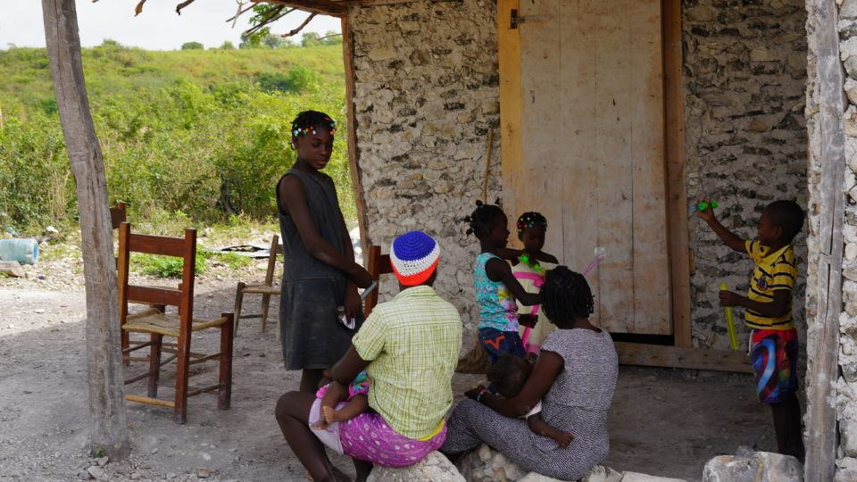 Roseberline and her family in Haiti.