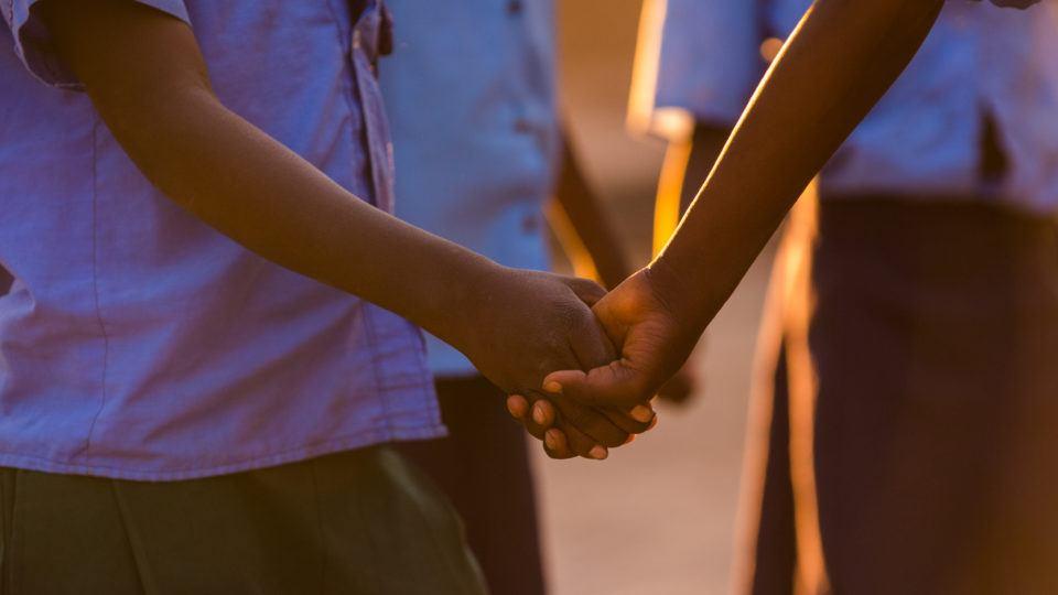 Children playing as the sun sets in Mwandi, Zambia.
