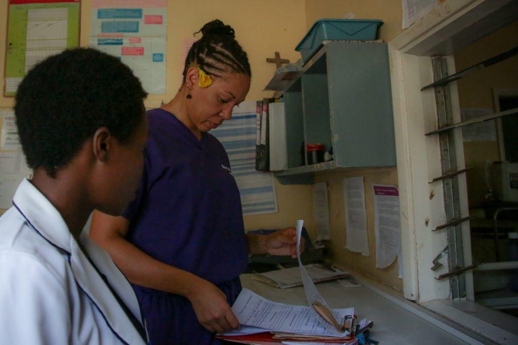 CMMB Volunteer mary Fleming reviewing charts