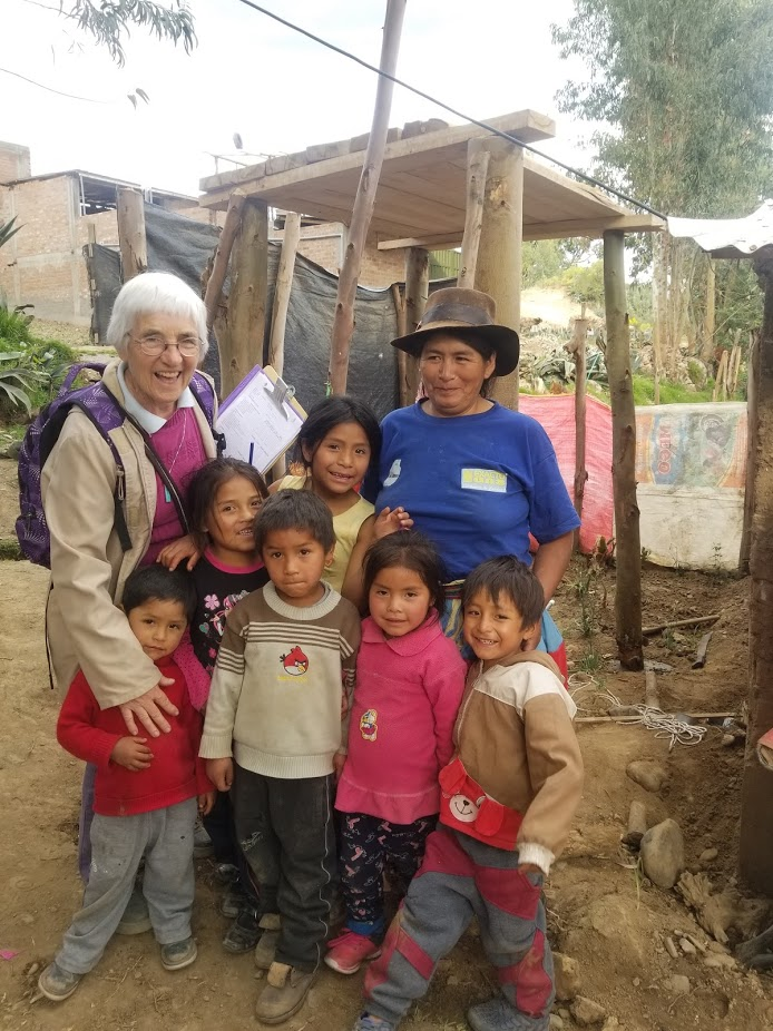 Hermana Yvette with a family who received a water tank this year