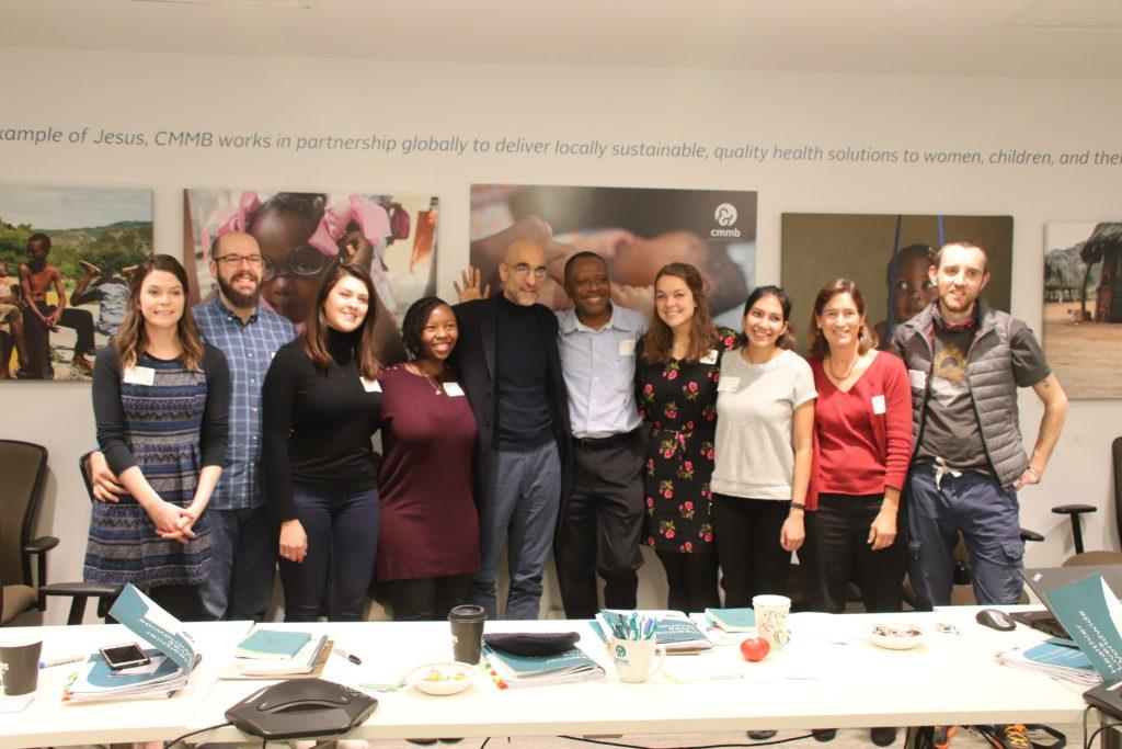 Dr. Tom takes a photo with our new cohort of volunteers.