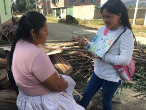 Gina teacing a community mother about hanwashing practices