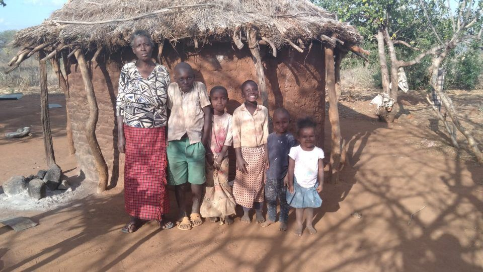 Musembi family in front of their home with grandma