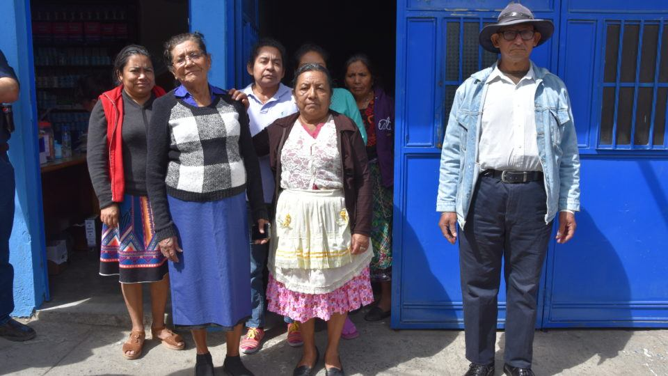 Patients standing outside the Santa ISabela Clinic