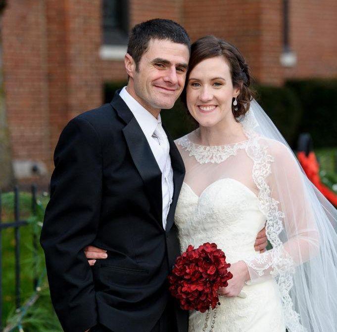 Sarah and Marting posing at their wedding