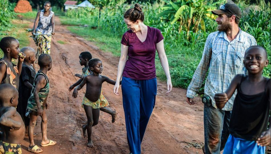 Sarah and Martin walking with children in South Sudan