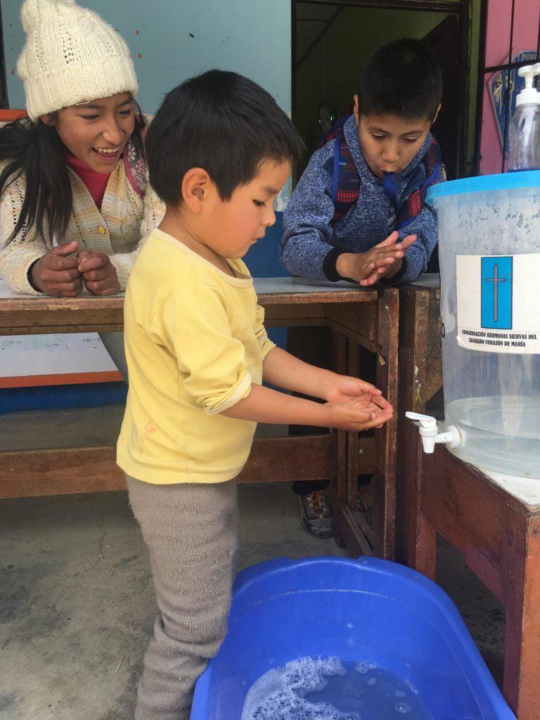 A little boy in Peru practices handwashing!