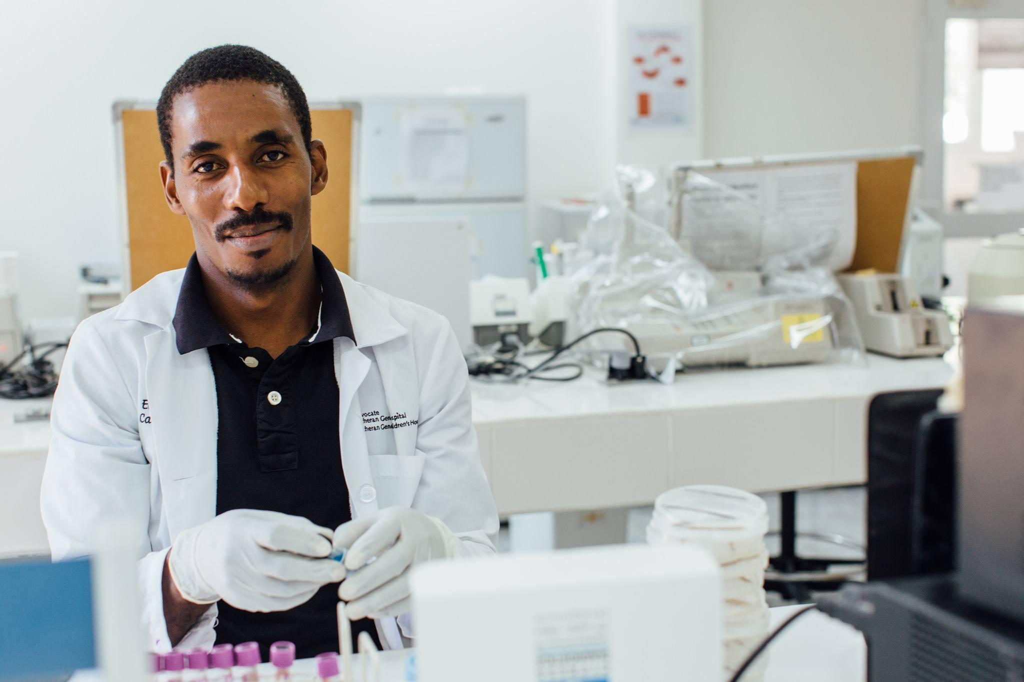 health worker in lab in haiti