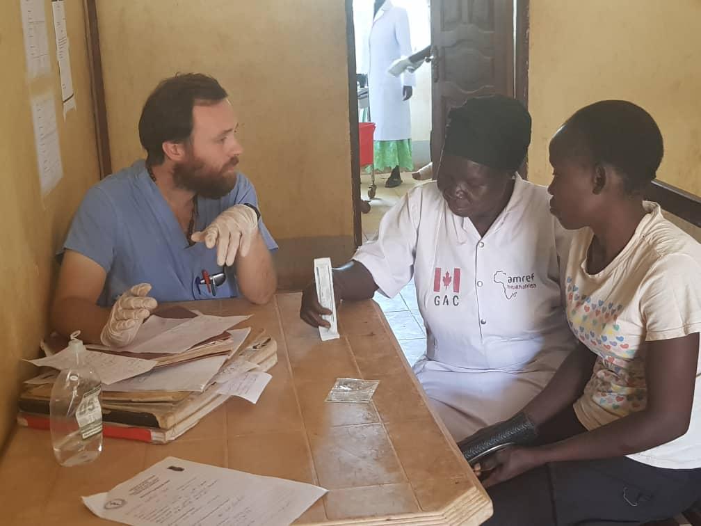 Daniel Maxwell, volunteer, attending to patients in South Sudan