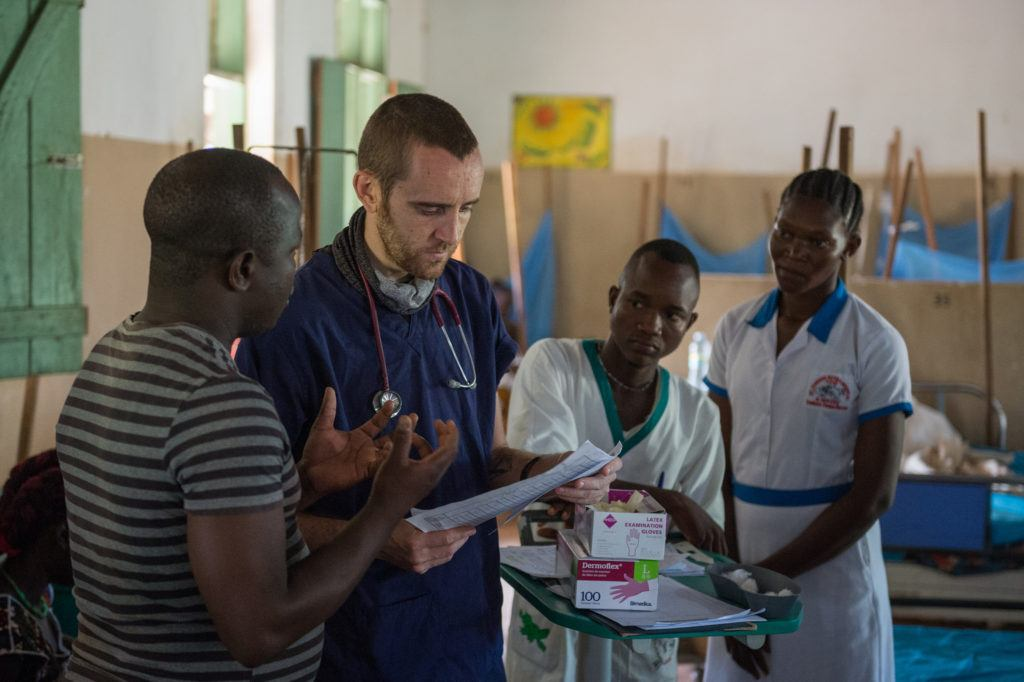 Dr. Matthew Jones with patients in South Sudan