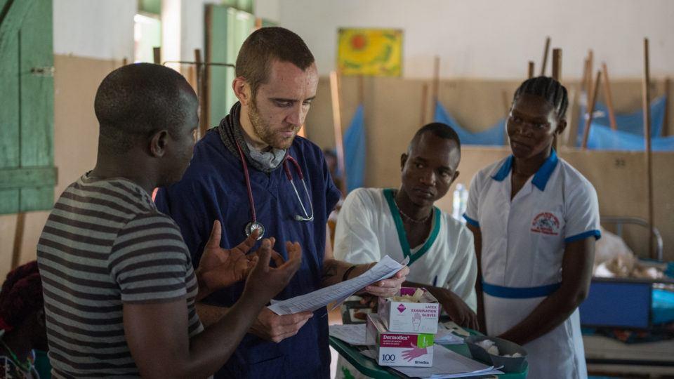 Dr. Matthew Jones with patients in South Sudan