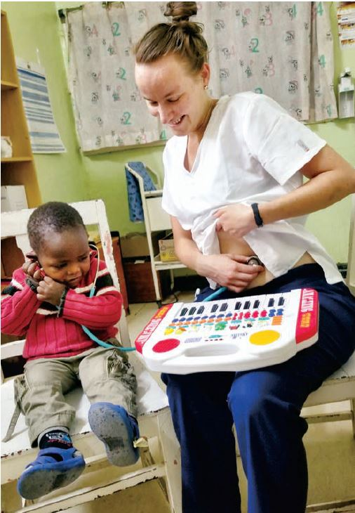 Joanna playing with a small patient at the Mitomo Mission Hospital in Kenya