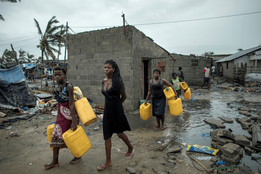 people with water cannisters after the cyclone