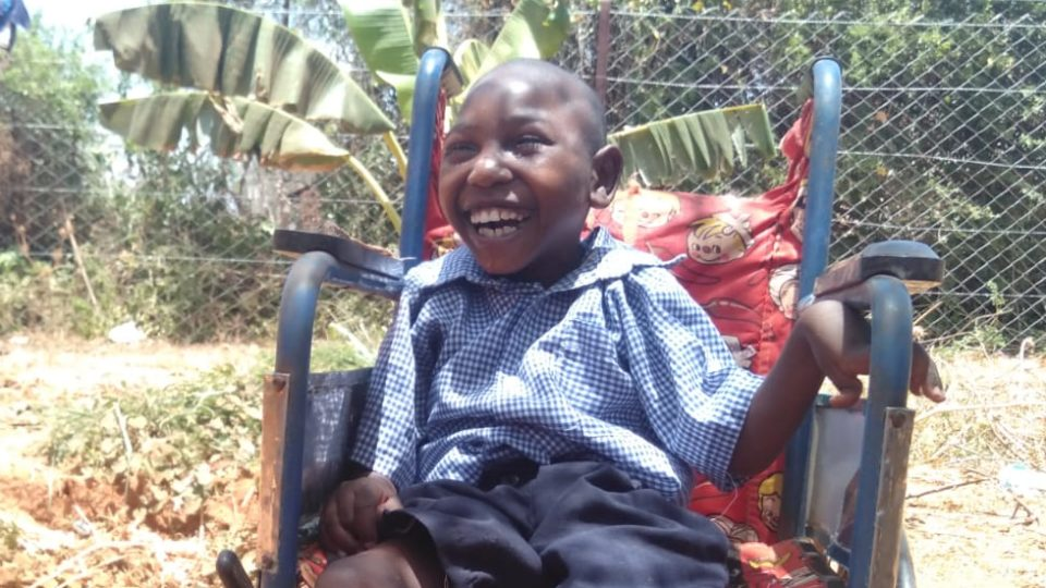 amos smiling in his wheelchair