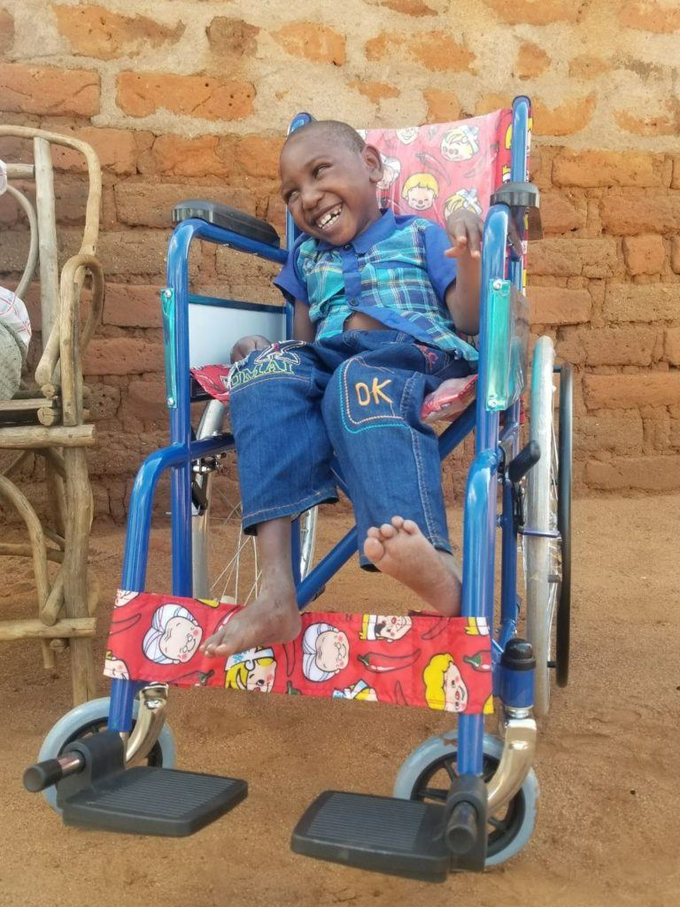 Amos and his wheelchair the day it was delivered