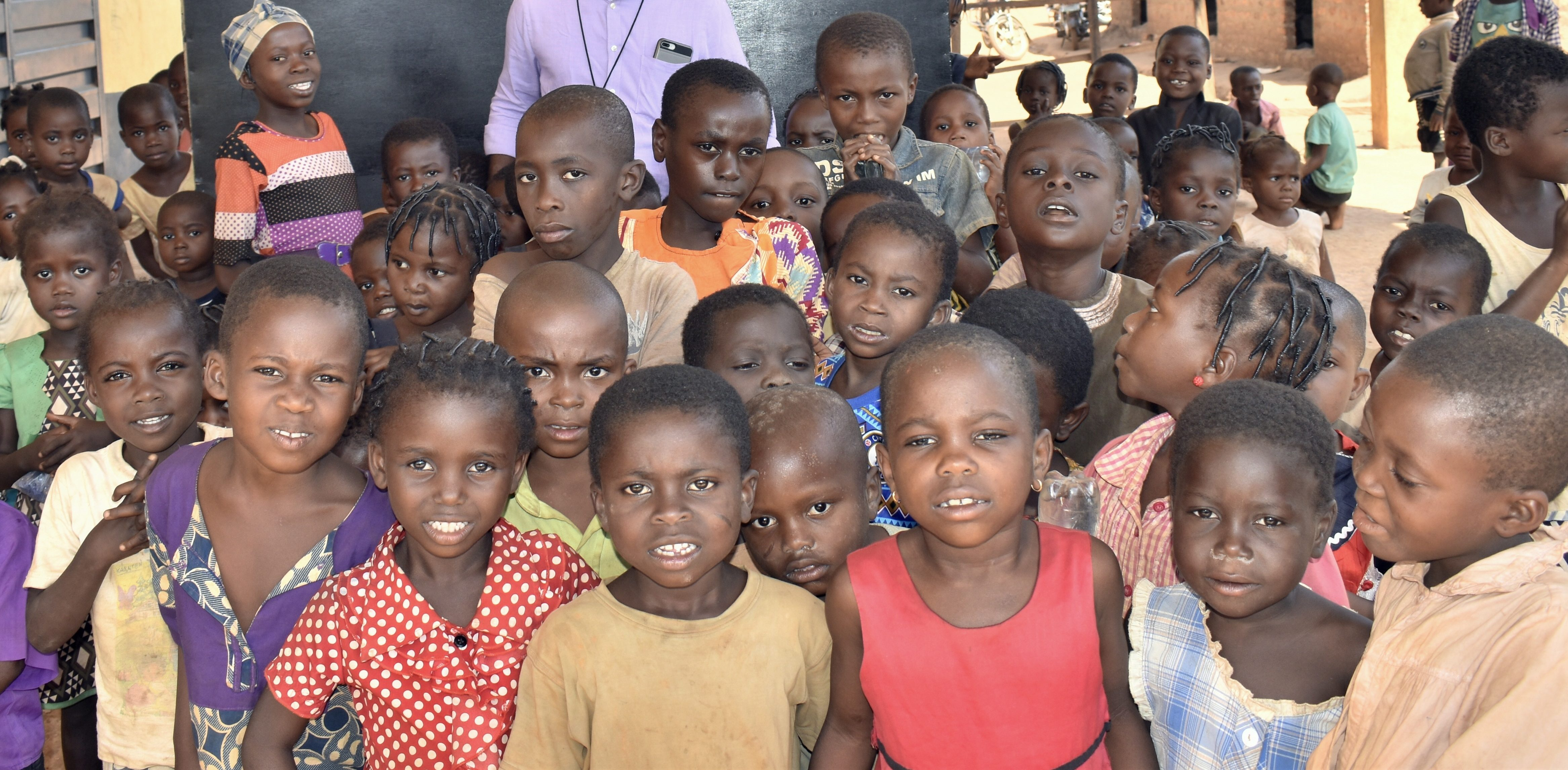 children in front of black board at refugee camp cameroon
