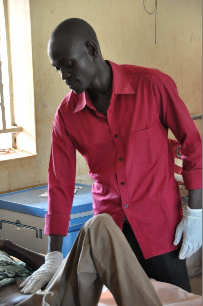 Photo of a health worker caring for a patient in Yambio South Sudan