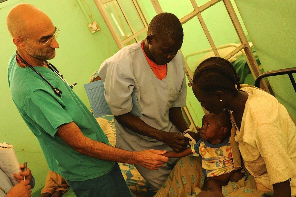 Dr. Tom treats a baby at the mother of mercy hospital in sudan.