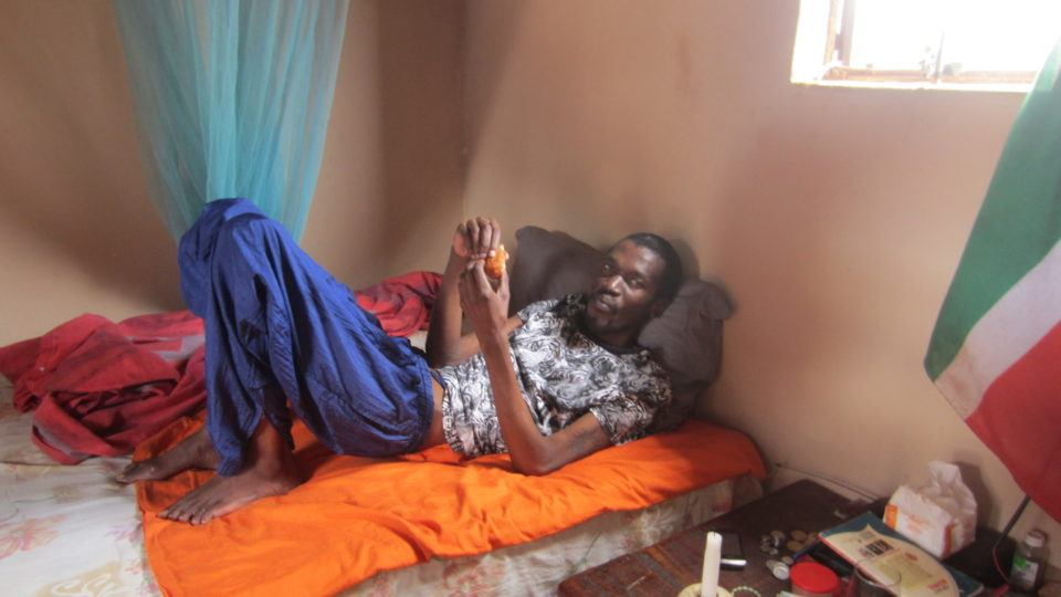 Khulani at his home, laying in bed