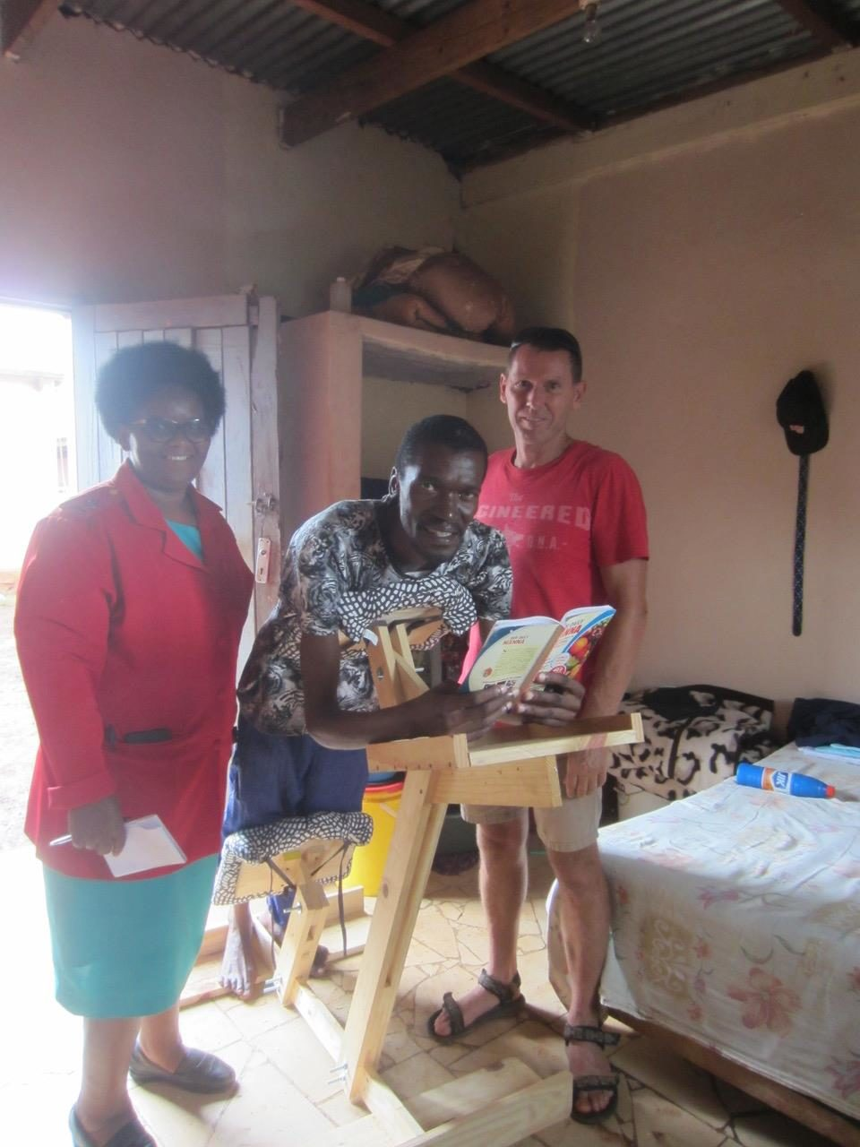Khulani with the operation hope team and his new chair