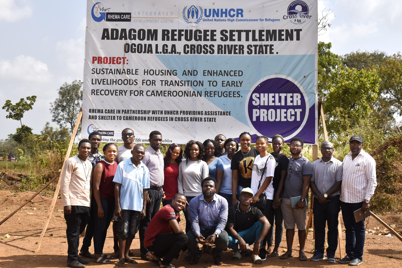 medical team outside sign for cameroonian refugee camp