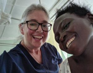 Patricia posing with a new mother she helped during the delivery process