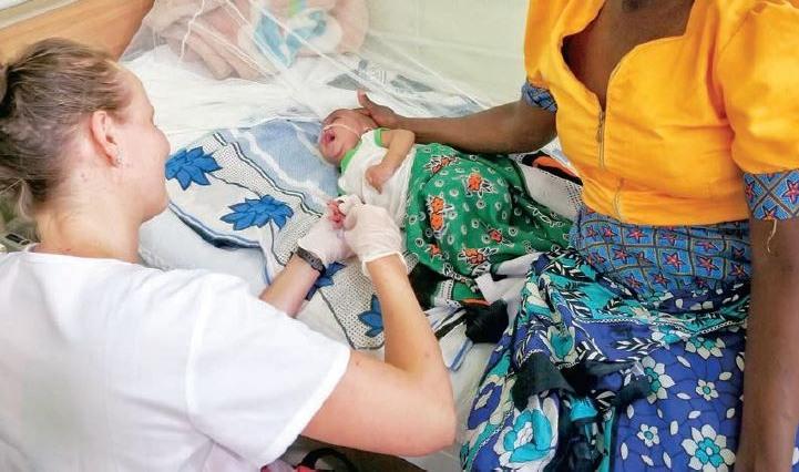 Joanna serving a newborn patient in Kenya