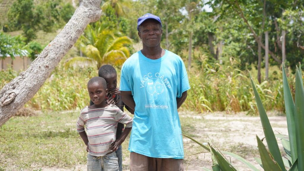 two children with their dad in Haiti