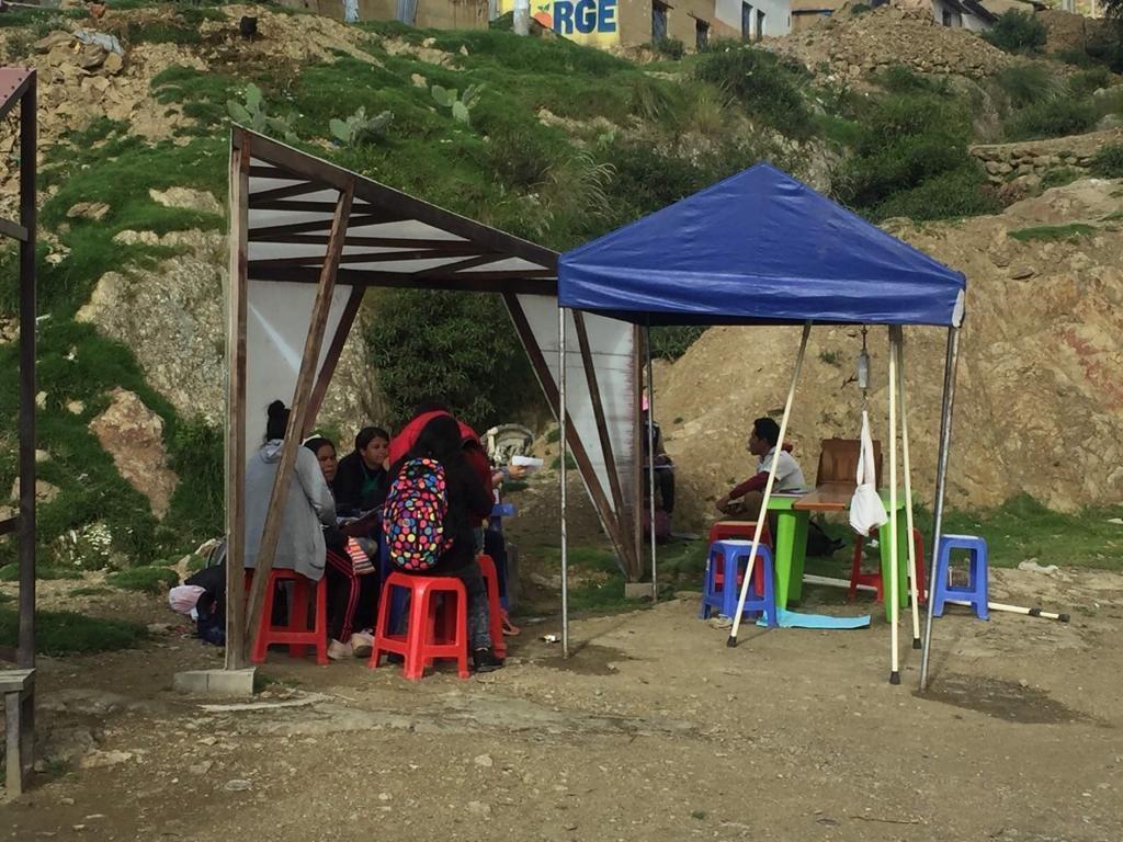 A measuring station in La Esperanza, Peru. Children's height, weight and hemoglobin levels are measured