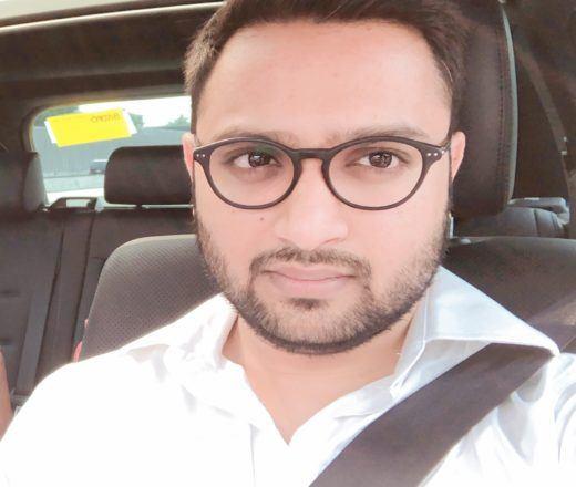 Head shot of volunteer Rakesh. He is sitting in a car